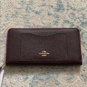 Coach burgundy saffiano leather zip around wallet